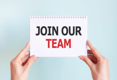 join our team word inscription white paper sheet hands woman